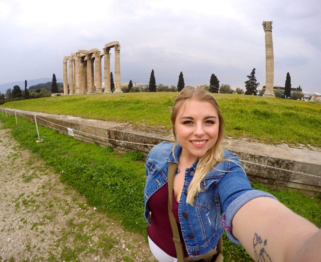 Sophie taking a selfie in front of the Temple of Zeus in Athens, Greece.