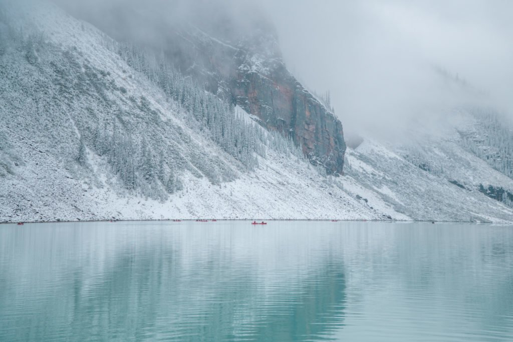 Visitors canoeing across the beautiful Lake Louise - one of the most popular activities to do in Banff, Canada.