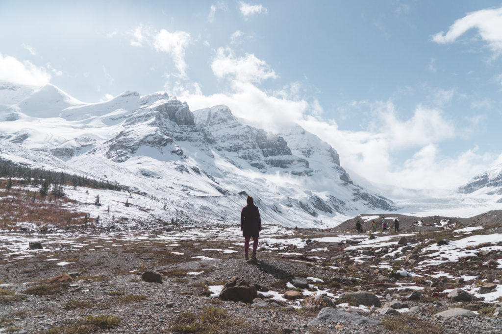 Standing in front of a huge mountain one can find on the Icefields Parkway.