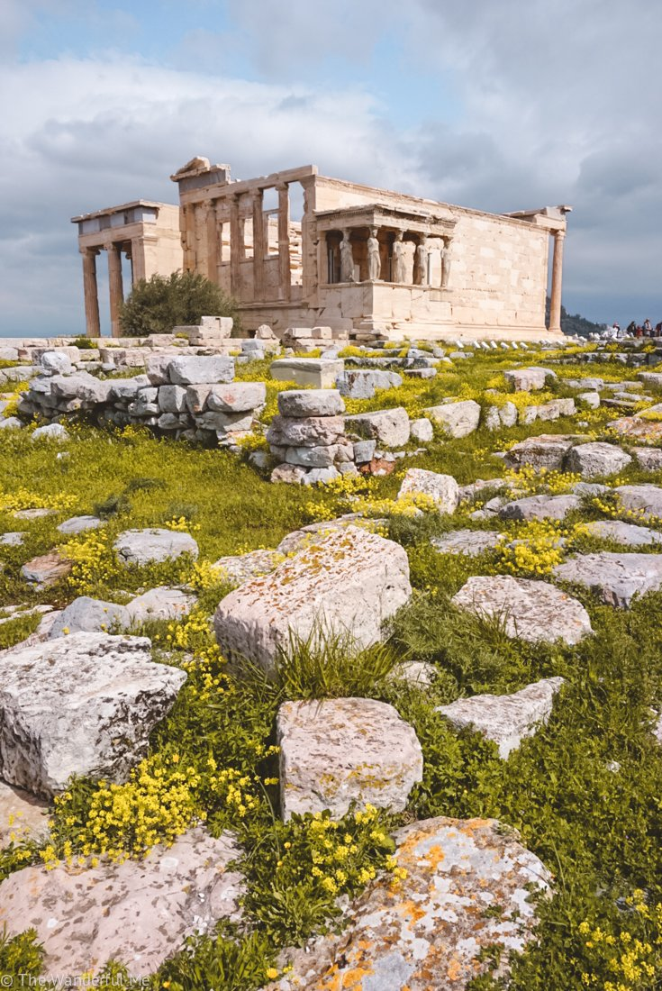 The Erechtheum in the background, with the ruins of the Old Temple of Athena in the foreground.