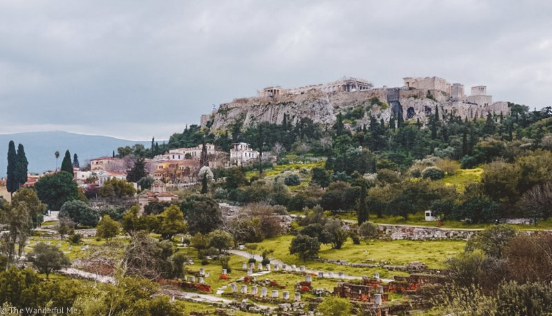 Views of the Acropolis, rising high above the city on top of its hill. This is no doubt one of the most popular ancient ruins in Athens, Greece.