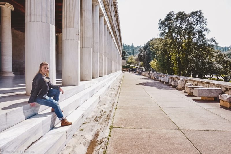 Sophie sitting on the steps of the Stoa of Attalos, admiring the view.