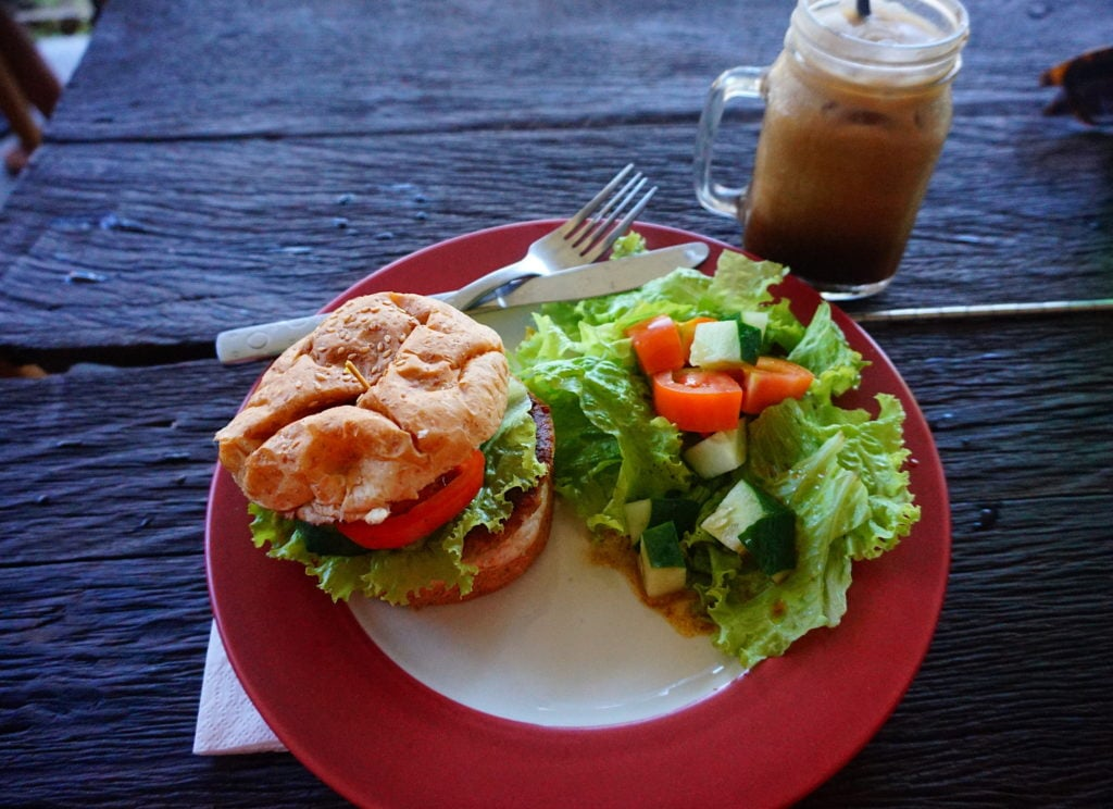 Rojo's Breakfast Bali vegan burger with a side salad and a mug of coconut coffee (picture from 2017).