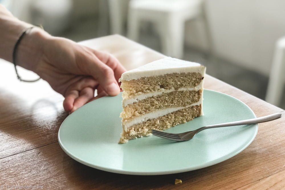 """A moist, delectable vanilla vegan cake with a creamy """"cream cheese"""" frosting from the vegan cafe I Am Vegan Babe."""