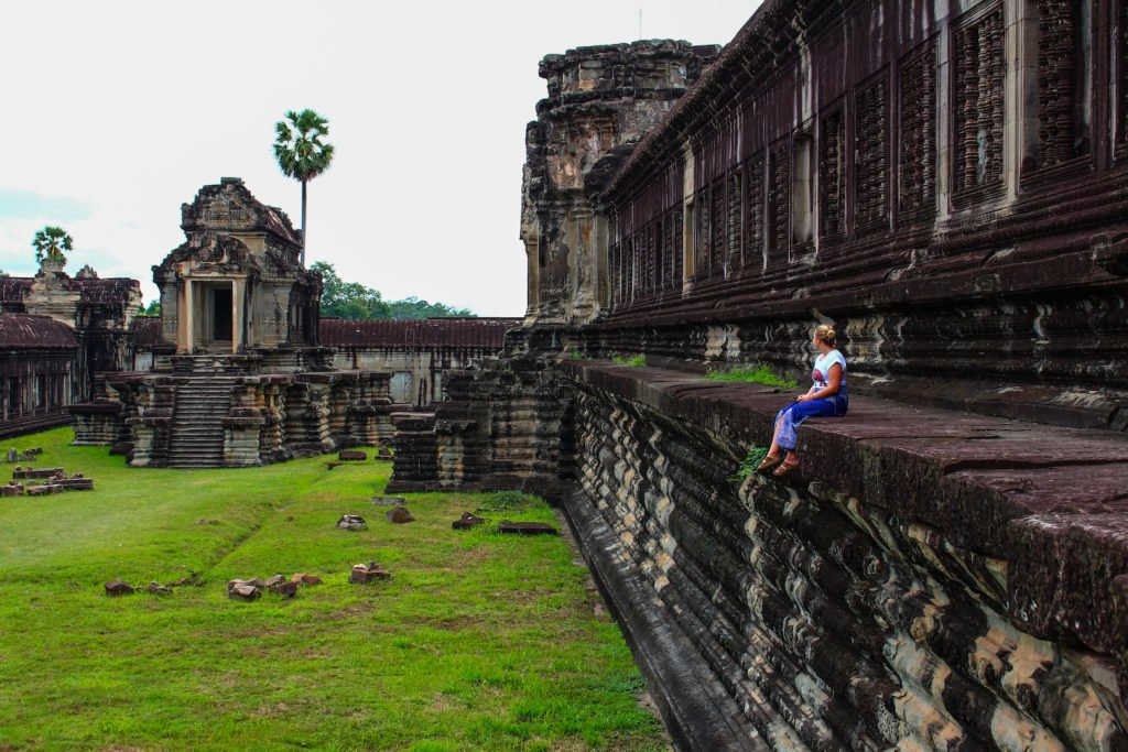 Sitting on Angkor Wat • Remarkable Tips to Make Traveling to Cambodia Easier | The Wanderful Me