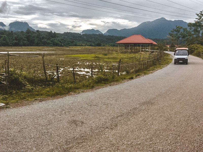 The breathtaking countryside near Vang Vieng featuring shimmering rice paddies, limestone karst mountains, and incredible views.