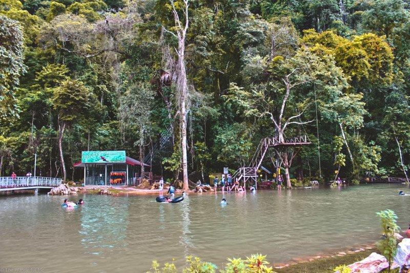 A packed blue lagoon near Vang Vieng that's not-so blue but still beautiful.