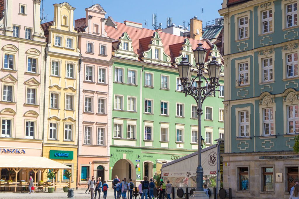 Cotton-candy, pastel-colored buildings of Wroclaw, a fairytale town that's a must when backpacking Eastern Europe for one month.