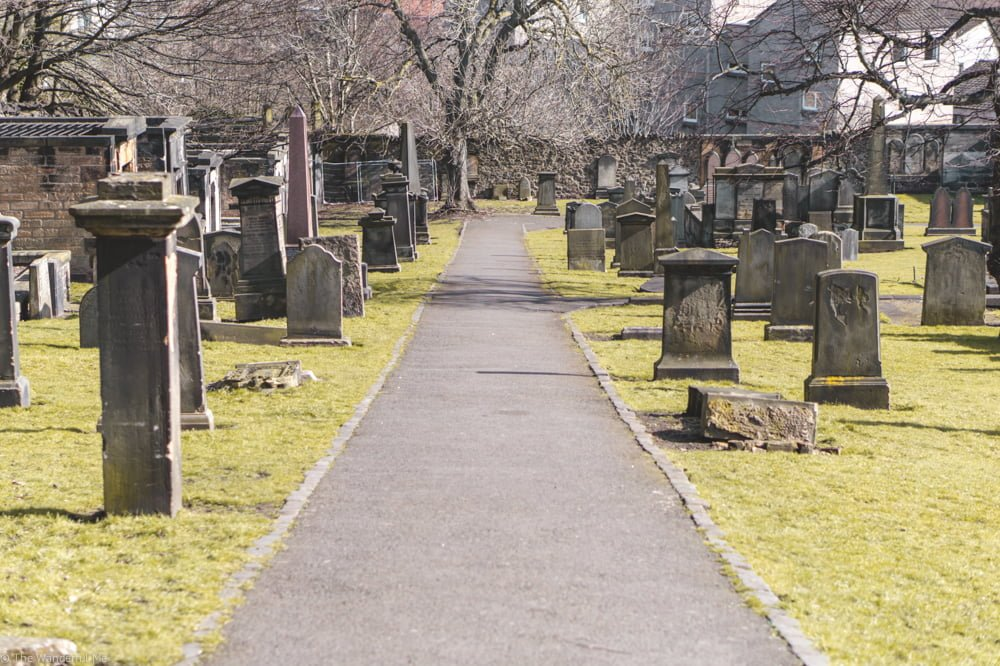 Numerous gravestones in an Edinburgh graveyard, some standing tall, other askew.