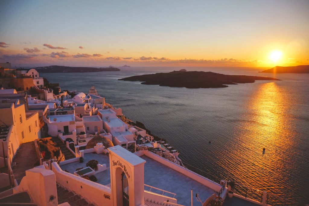 Santorini sunset. • Day Trip to Santorini from Athens Guide.