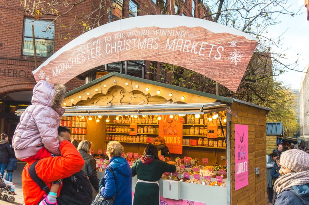 Christmas stand at the Manchester Christmas Market. • Manchester Christmas Market: 25 Photos to Inspire You to Visit