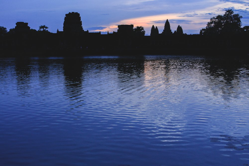 Deep, heavy clouds shrouding the Angkor Wat sunrise. • Angkor Wat Sunrise - The RIGHT Way to Do it + My Personal Experience