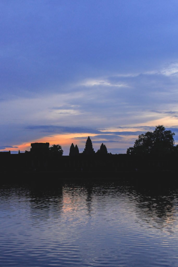 The best spot for sunrise over Angkor Wat is in front of the ponds for a beautiful reflection. • Angkor Wat Sunrise - The RIGHT Way to Do it + My Personal Experience