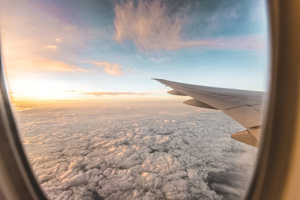 Plane wing. •Scoring Cheap Flights: The Top Sites I Use to Book Affordable Flights