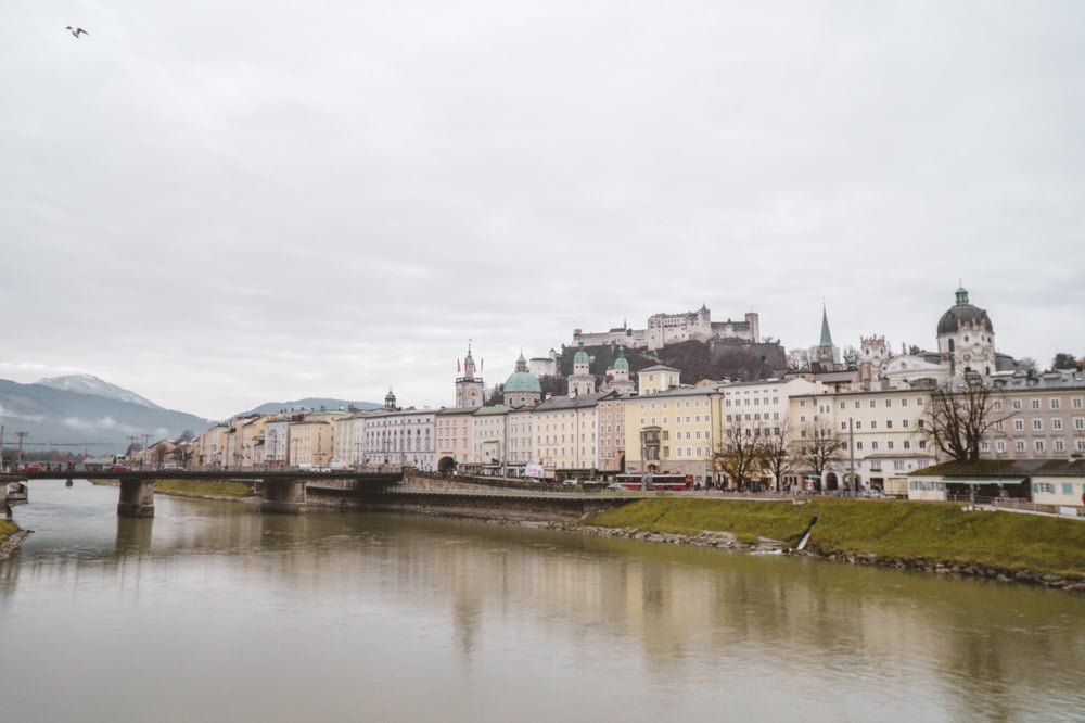 Admiring the city of Salzburg from one of the main bridges in the city with the Salzach River in the foreground.