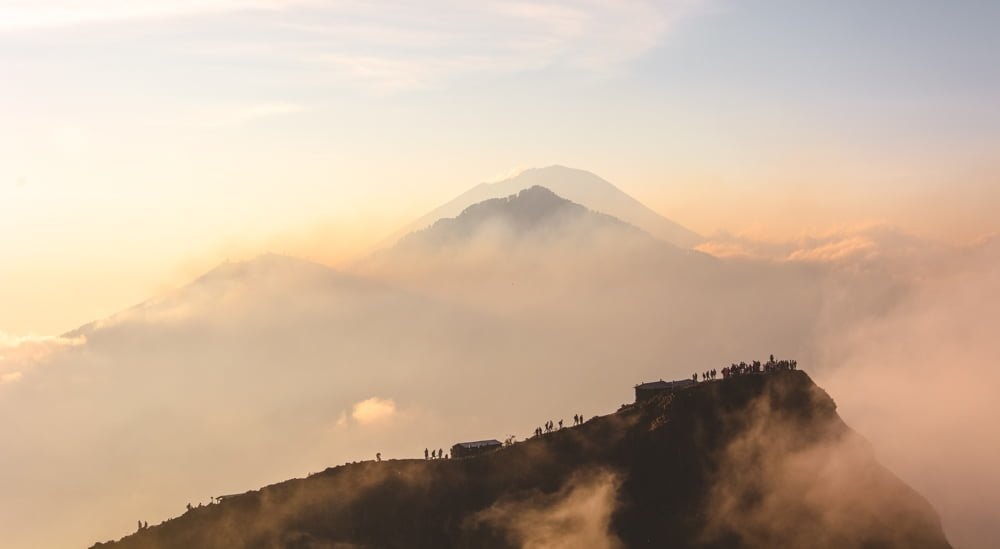 Hundreds of people gathered atop Mount Batur for sunrise. My first real experience with overtourism.
