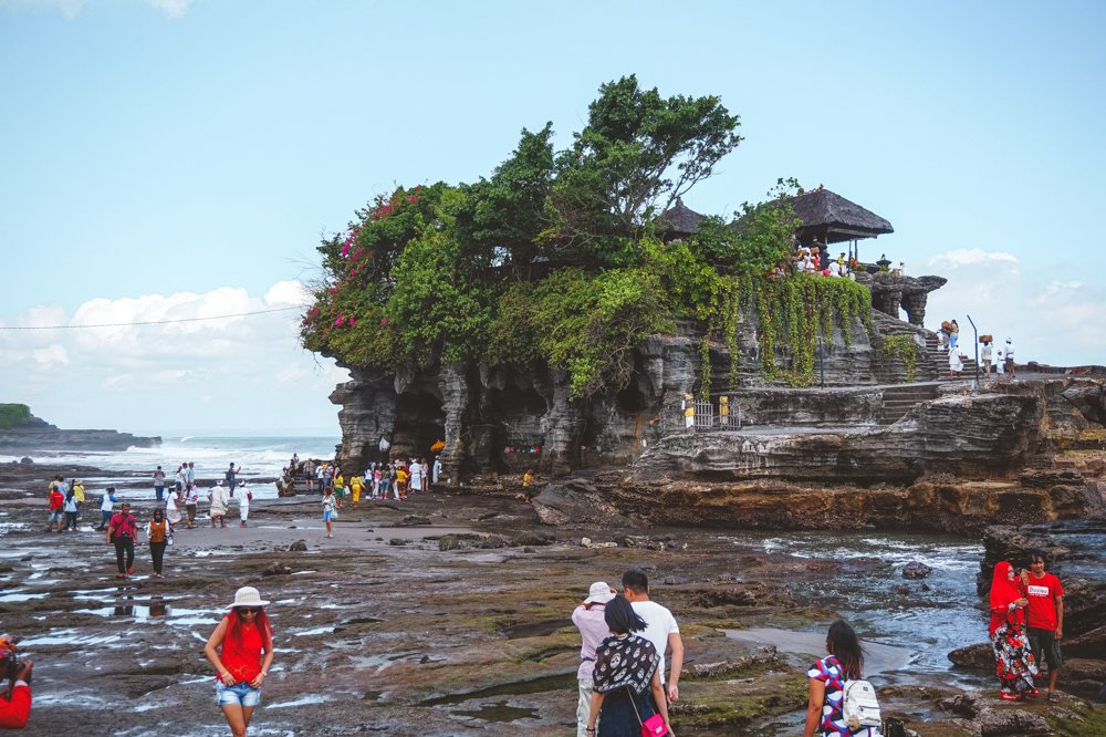 At Tanah Lot in Bali, when the tide runs low, the packs of tourists run high, all fighting for the chance to get a photo.