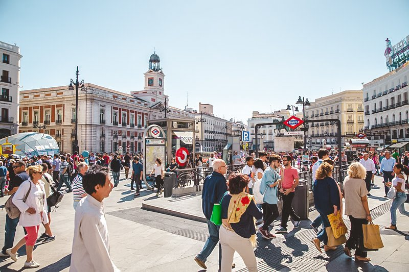 Heaps of tourists amongst a popular square in Madrid. Madrid, Spain, is just one of many cities attacking the Airbnb and home-sharing concept head on.