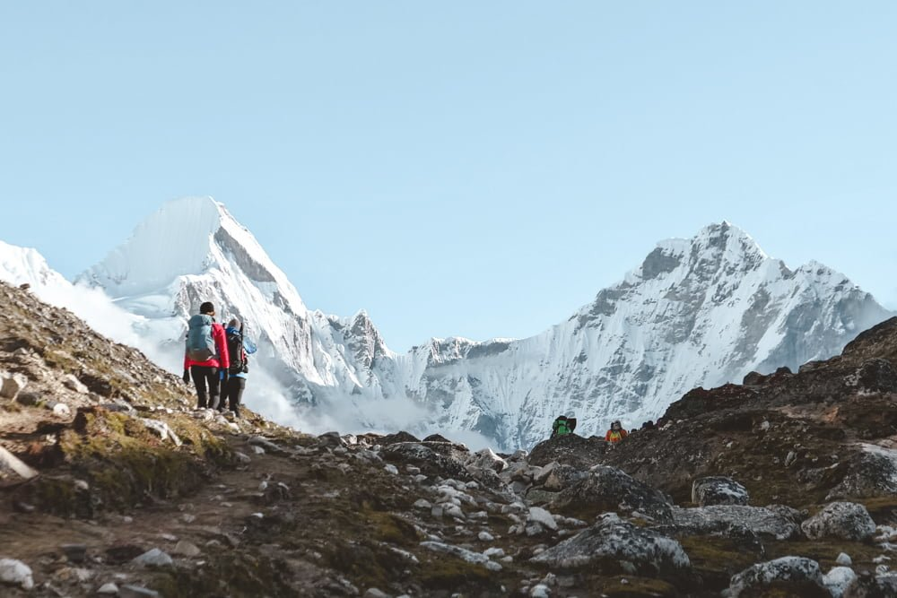 Hikers atop Mount Everest, where you can literally find frozen piles of poo from travelers.