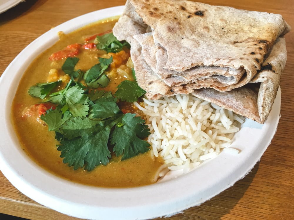 A big plate of vegan Indian curry from the quaint Hariprasad Samosa & Curry in Krakow, Poland.