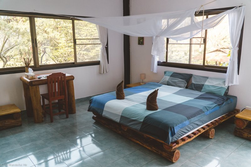 The comfortable private bedroom at Elephant Valley Thailand's homestay.