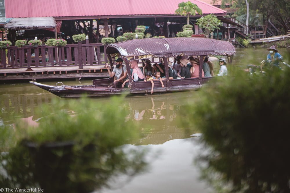 Hoards of tourists packed in a boat to float around the fake Ayutthaya floating market.