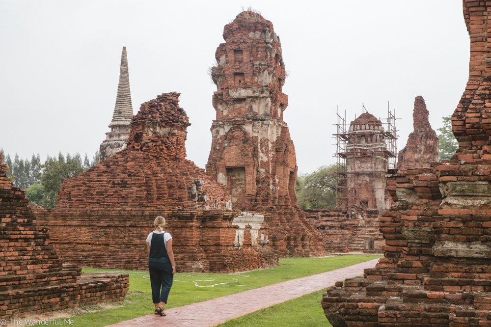 Sophie walks through the temple complex, admiring and awe-ing at the temples of Ayutthaya.