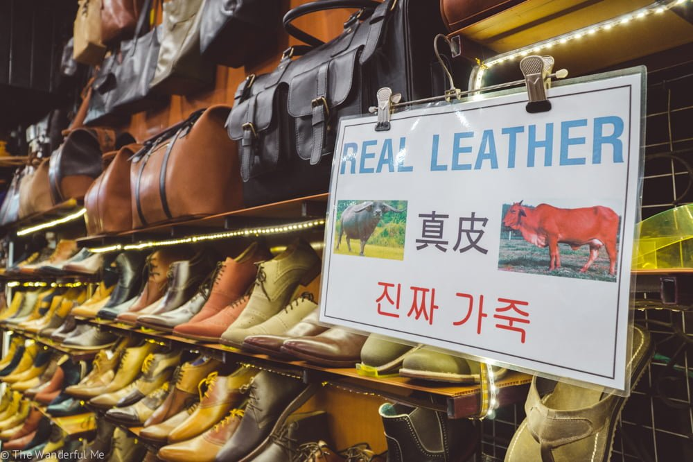 A sign promoting these shoes are made from real leather... which is completely unnecessary and definitely an unethical animal experience.