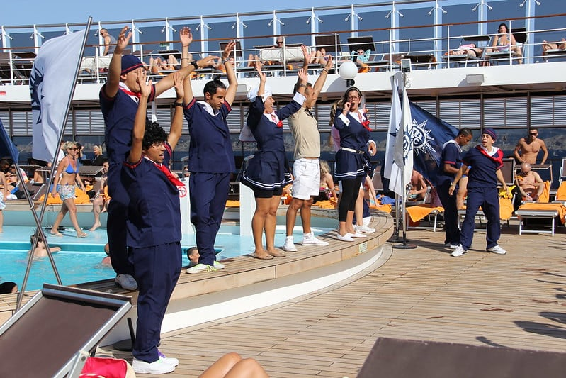 Cruise ship workers are entertaining guests on deck, but below deck they're treated like slaves.