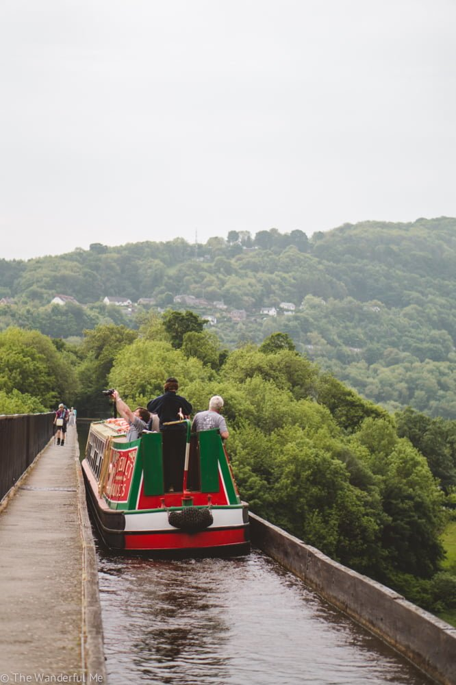 A barge makes its way across the Pontcysyllte Aquaduct, one of the best places to visit with kids in North Wales.