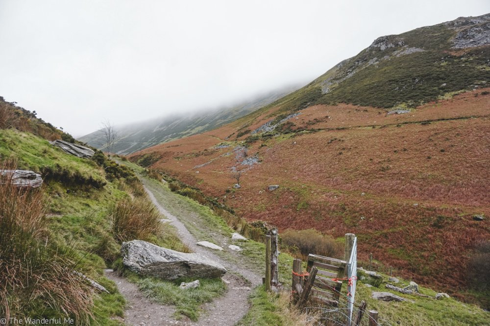 A public footpath winds its way through the classic hills of the North Wales countryside.