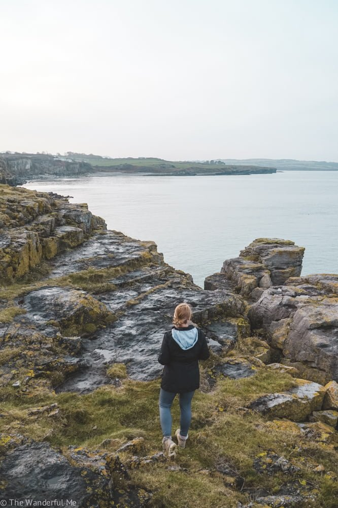 Sophie standing on the cliffside on the island of Anglesey in North Wales, a top tourist destination.