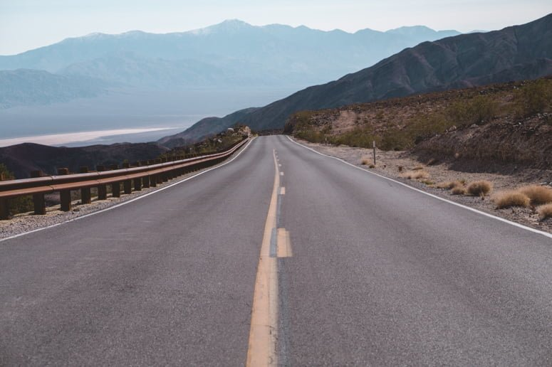 A wide open road, just waiting for you to rent an RV for your next trip so you can venture down it!