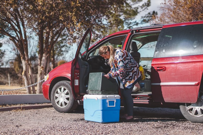 Sophie cooks lunch on the side of a road with a portable grill and a fully-loaded cooler!