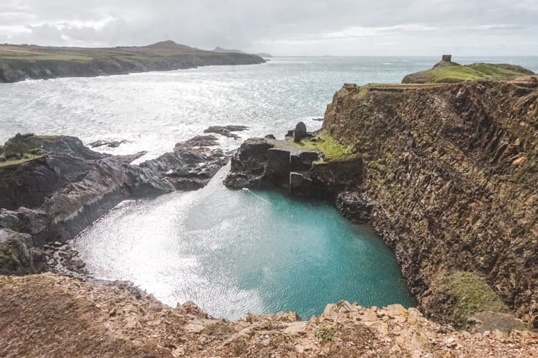 The Blue Lagoon with its turquoise waters and glistening sheen, located on the Pembrokeshire Coast in South Wales.