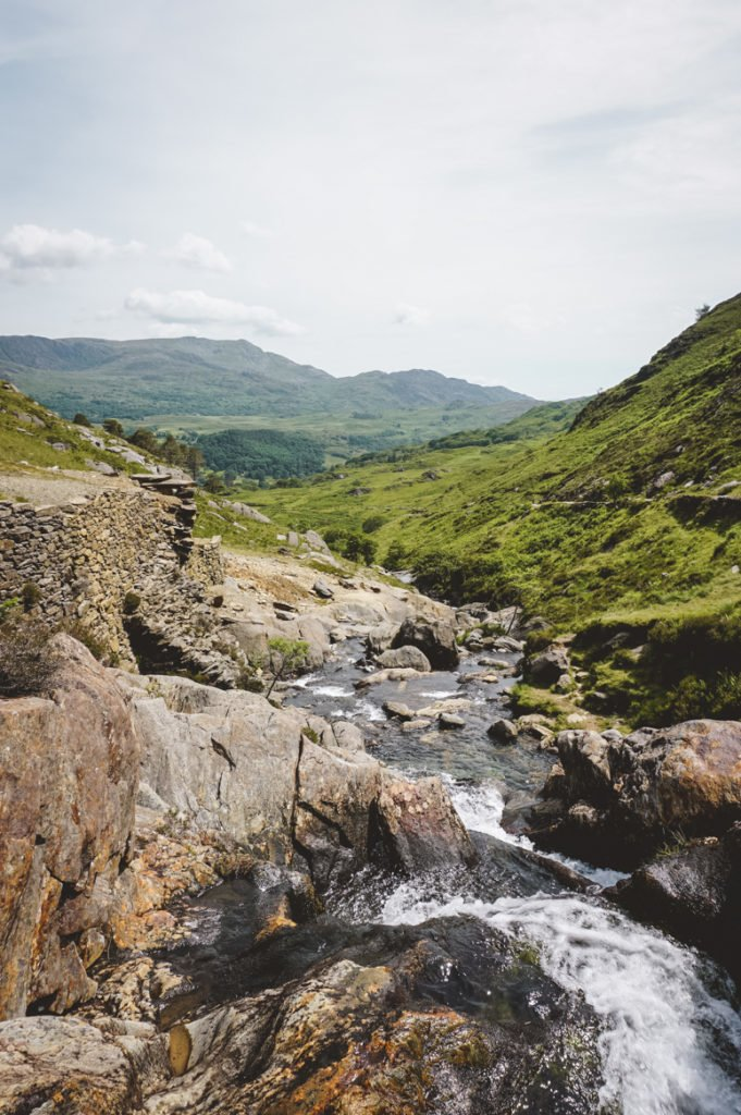 Waterfalls tumble down the mountains in North Wales, a great attraction in this region.