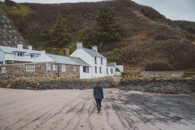 A friend walking along the beach in Wales.
