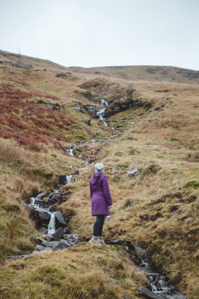 Sophie admiring a waterfall in Brecon Beacons National Park in Wales.