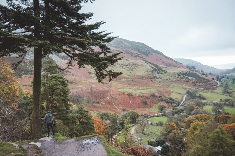 Dan standing and admiring one of the many picturesque valley views in Wales.