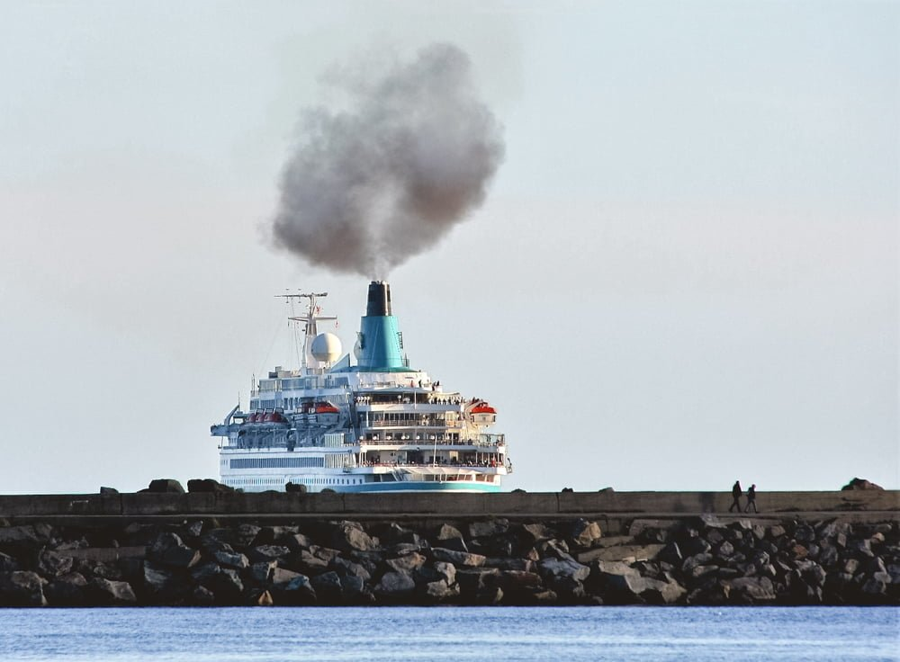 A packed cruise ship sailing out to sea, only to leave an unsustainable footprint and a crazy amount of pollution.