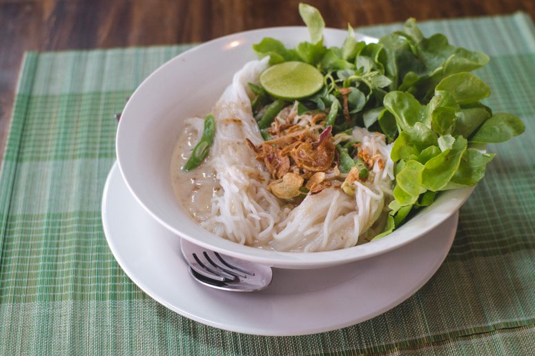 A packed Khao Soi soup, a traditional Northern Thailand food and a top vegan eat in Pai that you can't miss out on!