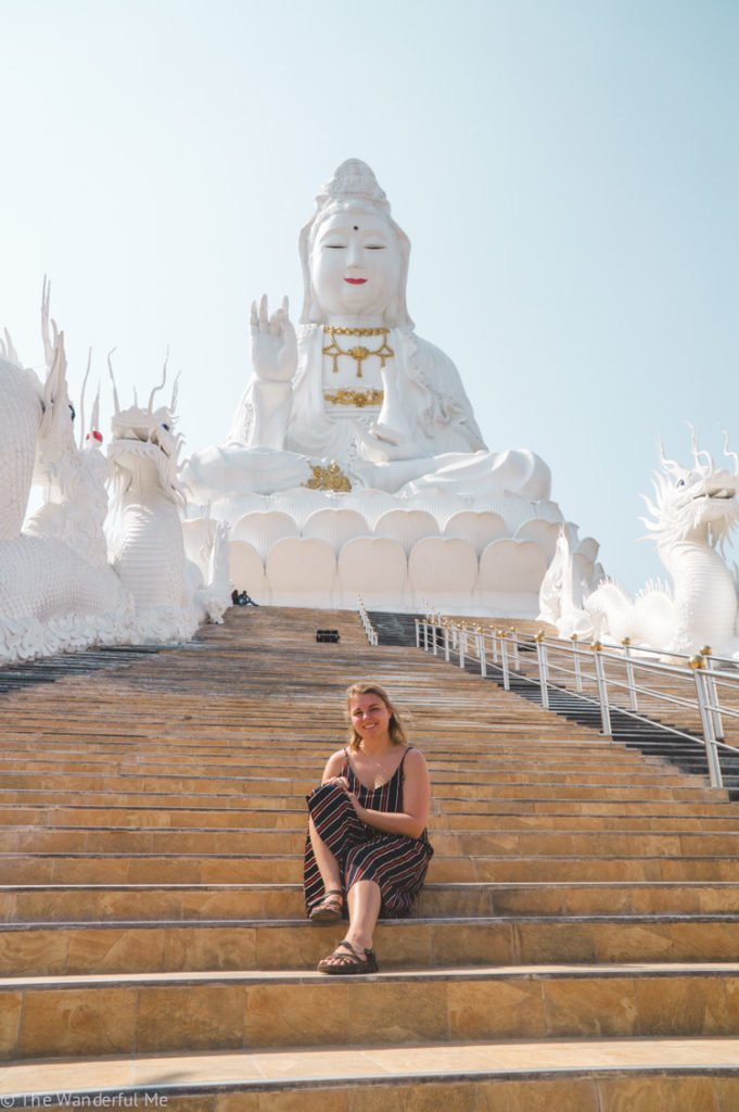 Sophie posing in front of one of the largest Buddha statues she's ever seen!