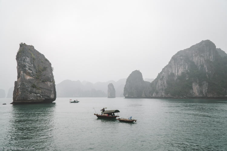 Limestone Karst rocks jut out of the waters in Halong Bay, a popular destination in Southeast Asia.