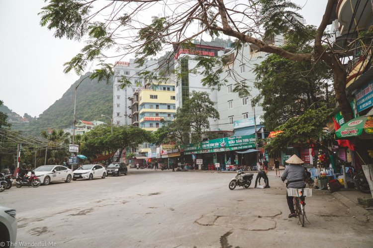 A bustling street on Cat Ba Island in Vietnam! Walking around little towns like this and exploring your accommodations options is a top budget tip.