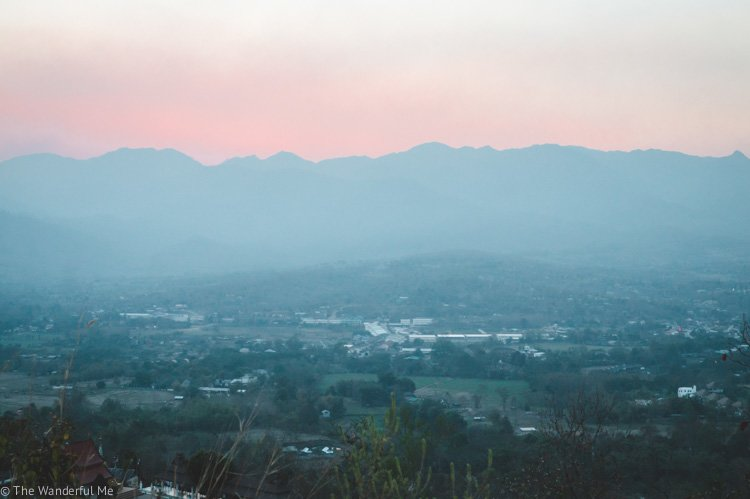 A hazy sunset in Pai, Thailand, due to the smoke from burning fields.