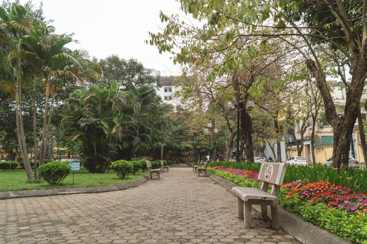 A peaceful park filled with colorful flowers and lush trees! We found it while walking around Hanoi, Vietnam.