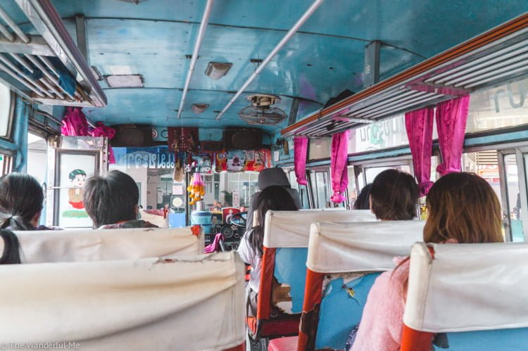 Packed buses with questionable safety are a common thing in Thailand but they're a great way to save money!