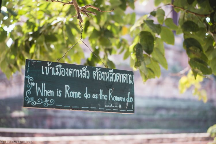 """A sign in Thailand saying """"When is Rome do as the Romans do."""""""
