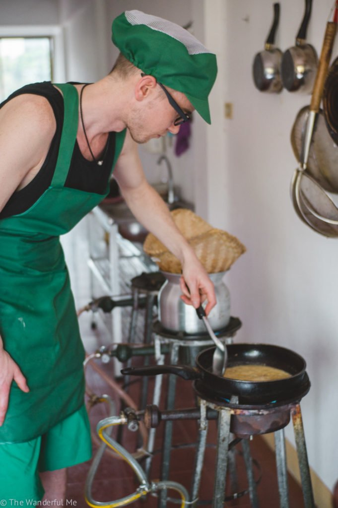 Dan cooking up some mouthwatering Thai curry over the fiery stove.