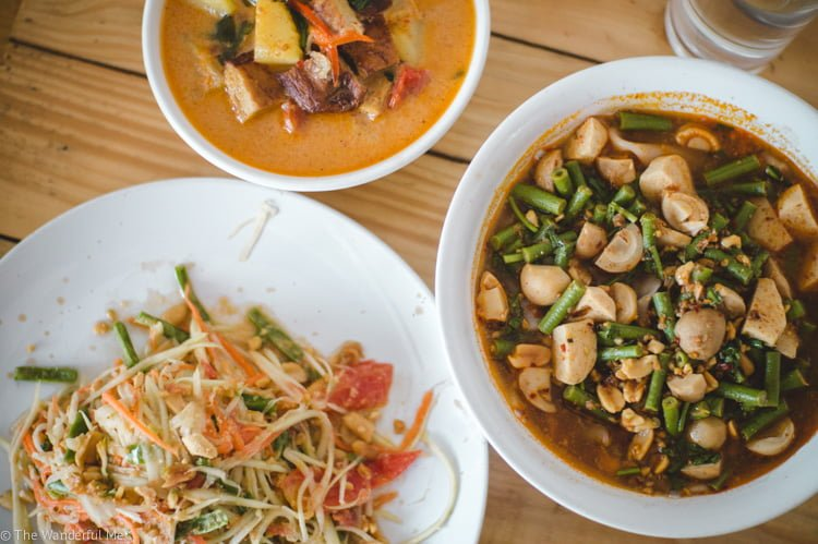 Vegan duck curry, tom yum soup, and papaya salad from the Taste of Heaven vegan cooking class in Chiang Mai.
